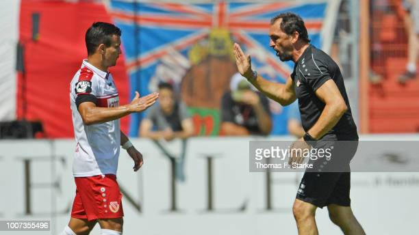 Head coach Claus - Dieter Wollitz of Cottbus shakes hands with Andrej Startsev of Cottbus during the 3. Liga match between FC Energie Cottbus and...