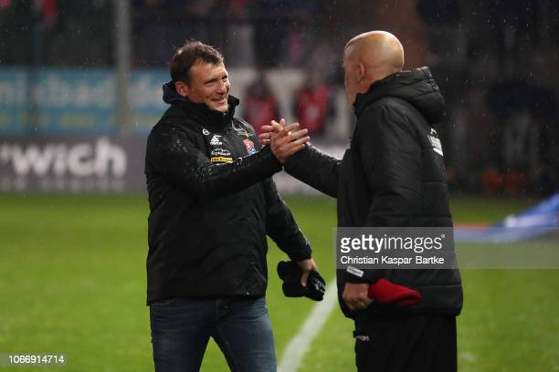 Head coach Claus Schromm of SpVgg Unterhaching and Head coach Michael Frontzeck of Kaiserslautern shake hands prior to the 3 Liga match between SpVgg...