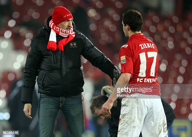 Head coach Claus-Dieter Wollitz of Cottbus and Daniel Ziebig are seen after the Second Bundesliga match between FC Energie Cottbus and MSV Duisburg...