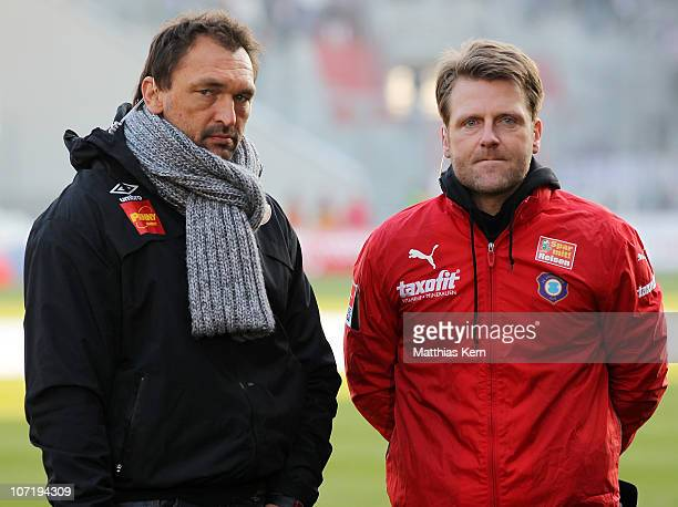 Head coach Claus-Dieter Wollitz of Cottbus and head coach Rico Schmitt of Aue are seen prior to the Second Bundesliga match between FC Energie...