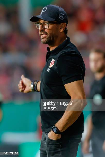 Head coach Claus-Dieter Wollitz of Energie Cottbus gestures during the DFB Cup first round match between Energie Cottbus and FC Bayern Muenchen at...