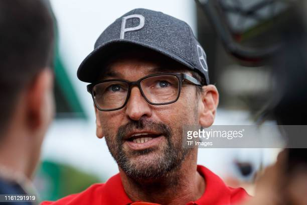 Head coach Claus-Dieter Wollitz of Energie Cottbus gives an interview prior to the DFB Cup first round match between Energie Cottbus and FC Bayern...