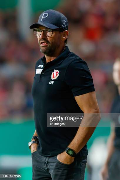 Head coach Claus-Dieter Wollitz of Energie Cottbus looks on during the DFB Cup first round match between Energie Cottbus and FC Bayern Muenchen at...