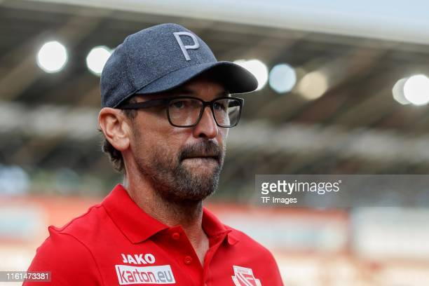 Head coach Claus-Dieter Wollitz of Energie Cottbus looks on prior to the DFB Cup first round match between Energie Cottbus and FC Bayern Muenchen at...