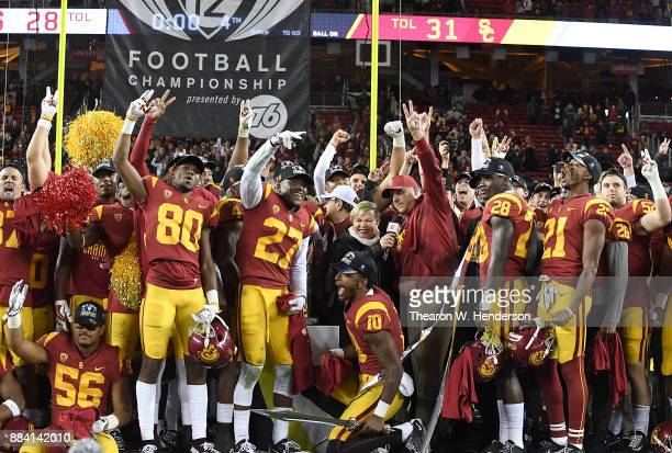 Head coach Clay Helton of the USC Trojans and his team celebrates after they beat the Stanford Cardinal 3128 in the Pac12 Football Championship Game...