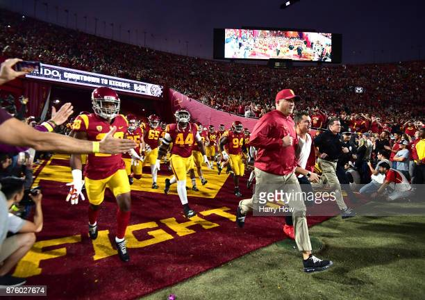 Head coach Clay Helton of the USC Trojans leads his team on to the field to face the UCLA Bruins at Los Angeles Memorial Coliseum on November 18 2017...