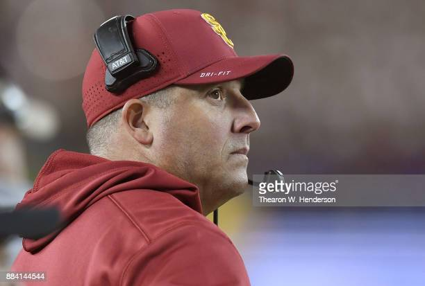 Head coach Clay Helton of the USC Trojans looks on from the sidelines against the Stanford Cardinal during the Pac12 Football Championship Game at...