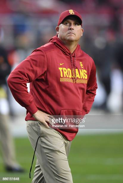Head coach Clay Helton of the USC Trojans looks on while his team warms up prior to the start of the Pac12 Football Championship Game against the...