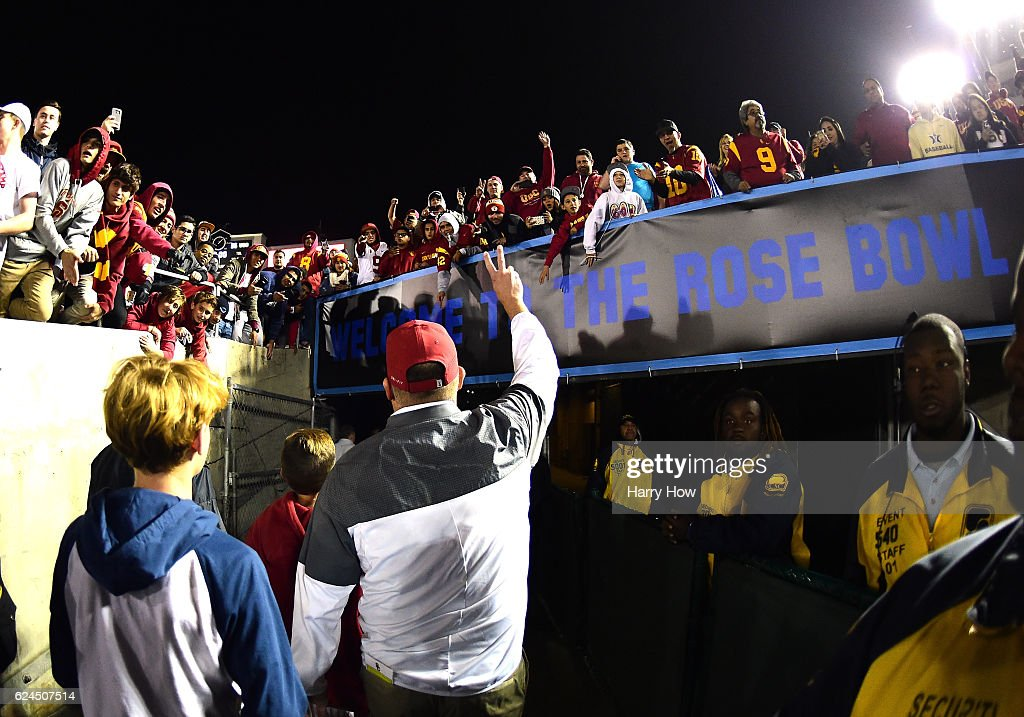 Head Coach Clay Helton of the USC Trojans salutes fans as he leaves the field after a 36-14 win over the UCLA Bruins at Rose Bowl on November 19, 2016 in Pasadena, California.