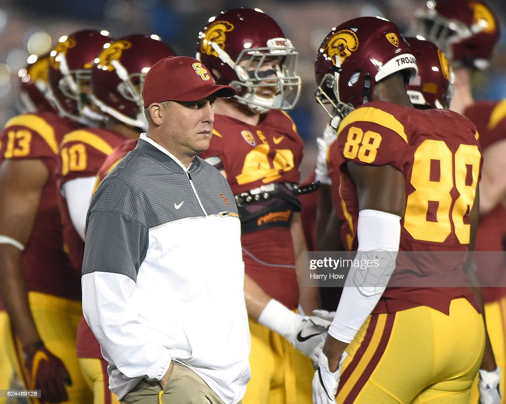 Head Coach Clay Helton of the USC Trojans walks the field during warm up before the game against the UCLA Bruins at Rose Bowl on November 19, 2016 in Pasadena, California.