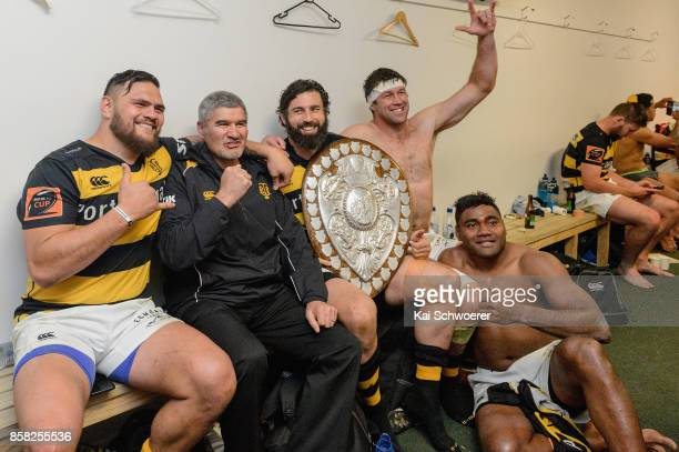 Head Coach Colin Cooper of Taranaki poses with his players and the Ranfurly Shield after the win in the round eight Mitre 10 Cup match between...