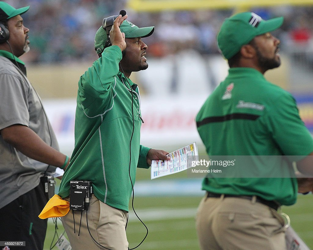 Head coach Corey Chamblin of the Saskatchewan Roughriders gestures from the sidelines in first half action in a CFL game against the Winnipeg Blue Bombers at Investors Group Field on August 7, 2014 in Winnipeg, Manitoba, Canada.