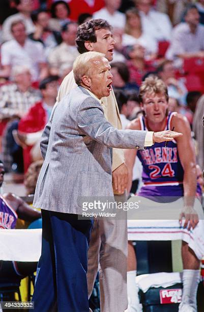 Head Coach Cotton Fitzimmons of the Phoenix Suns looks on against the Sacramento Kings circa 1989 at Arco Arena in Sacramento California NOTE TO USER...