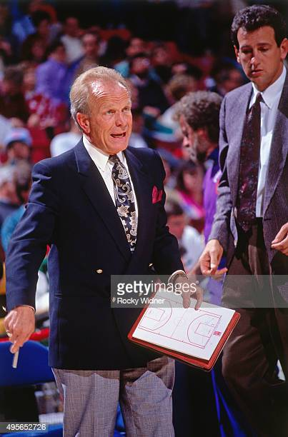 Head Coach Cotton Fitzsimmons of the Phoenix Suns diagrams a play against the Sacramento Kings circa 1991 at Arco Arena in Sacramento California NOTE...