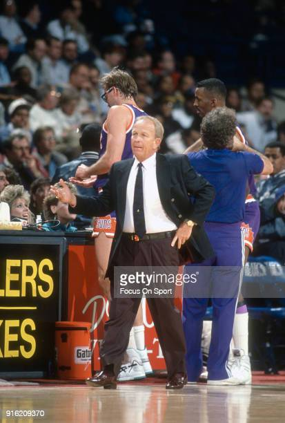 Head coach Cotton Fitzsimmons of the Phoenix Suns looks on against the Washington Bullets during an NBA basketball game circa 1990 at the Capital...