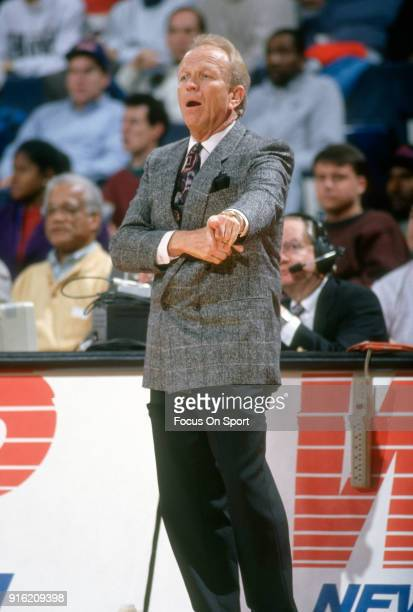 Head coach Cotton Fitzsimmons of the Phoenix Suns looks on against the Washington Bullets during an NBA basketball game circa 1992 at the Capital...