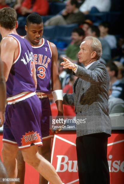 Head coach Cotton Fitzsimmons of the Phoenix Suns talks with his player Cedric Cibolos during an NBA basketball game against the Washington Bullets...
