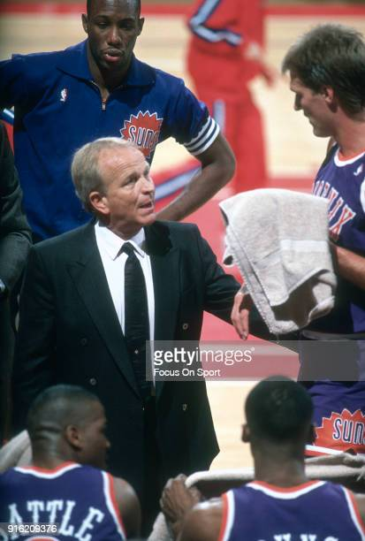 Head coach Cotton Fitzsimmons of the Phoenix Suns talks with his player Tom Chambers during an NBA basketball game against the Washington Bullets...