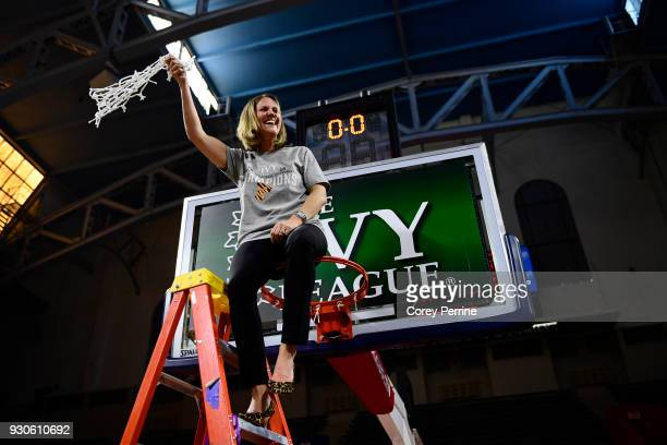 Head coach Courtney Banghart of the Princeton Tigers twirls the net to toss it to her players after the win of the Women's Ivy League Tournament...