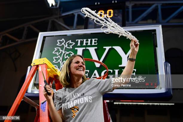 Head coach Courtney Banghart of the Princeton Tigers twirls the netting she cut down after the win at The Palestra on March 11 2018 in Philadelphia...
