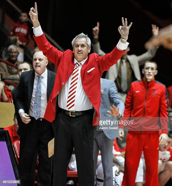 Head Coach Craig Neal of the New Mexico Lobos sends his players signals from the sidelines during their game against the Colorado State Rams at The...