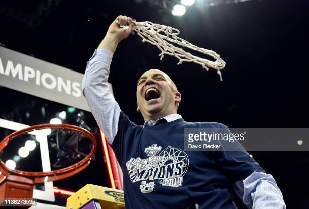 Head coach Craig Smith of the Utah State Aggies celebrates after his team defeated the San Diego State Aztecs during the championship game of the...