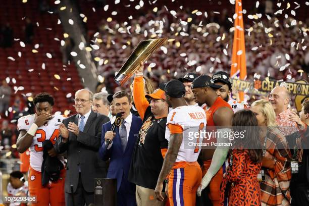Head coach Dabo Swinney and Trayvon Mullen of the Clemson Tigers celebrate their teams 4416 win over the Alabama Crimson Tide with the trophy in the...