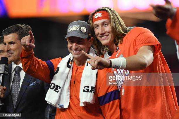 Head coach Dabo Swinney and Trevor Lawrence of the Clemson Tigers celebrate their teams 29-23 win over the Ohio State Buckeyes in the College...