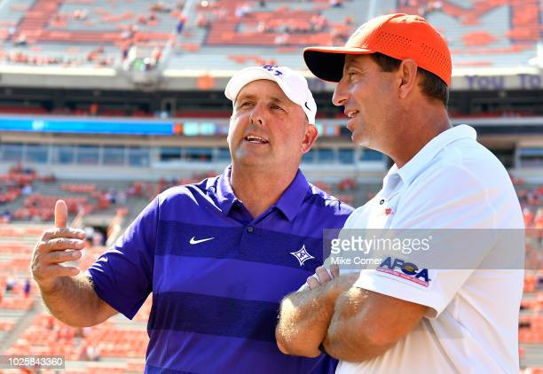 Head coach Dabo Swinney of the Clemson Tigers and head coach Clay Hendrix of the Furman Paladins talk at midfield prior to the start of their...