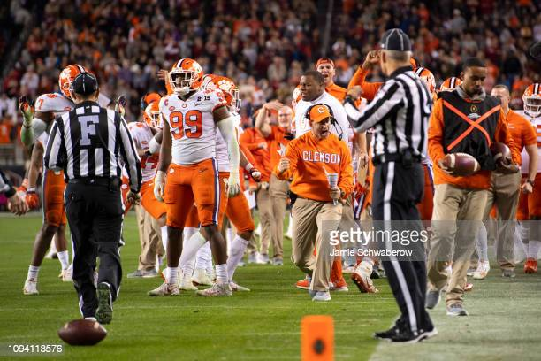 Head Coach Dabo Swinney of the Clemson Tigers and his team celebrate a defensive stop against the Alabama Crimson Tide during the College Football...