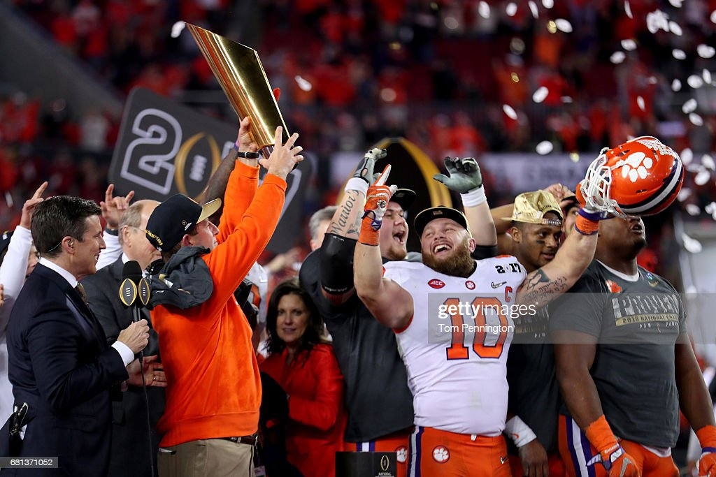 Head coach Dabo Swinney of the Clemson Tigers (L) and linebacker Ben Boulware #10 celebrate after defeating the Alabama Crimson Tide 35-31 to win the 2017 College Football Playoff National Championship Game at Raymond James Stadium on January 9, 2017 in Tampa, Florida.
