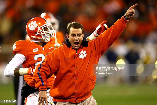 Head coach Dabo Swinney of the Clemson Tigers celebrates after a ruling on the field during their game against the Georgia Tech Yellow Jackets at...
