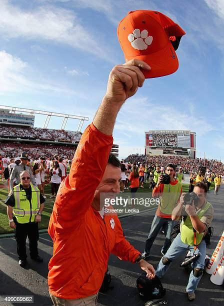 Head coach Dabo Swinney of the Clemson Tigers celebrates after defeating the South Carolina Gamecocks 3732 at WilliamsBrice Stadium on November 28...