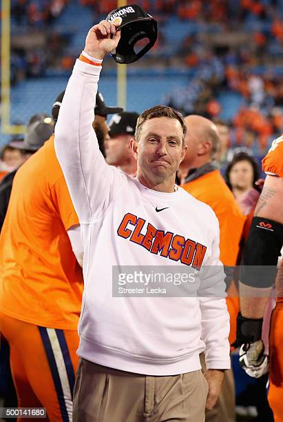 Head coach Dabo Swinney of the Clemson Tigers celebrates after defeating the North Carolina Tar Heels 4537 at the Atlantic Coast Conference Football...