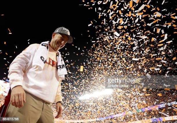 Head coach Dabo Swinney of the Clemson Tigers celebrates after defeating the Miami Hurricanes 383 in the ACC Football Championship at Bank of America...
