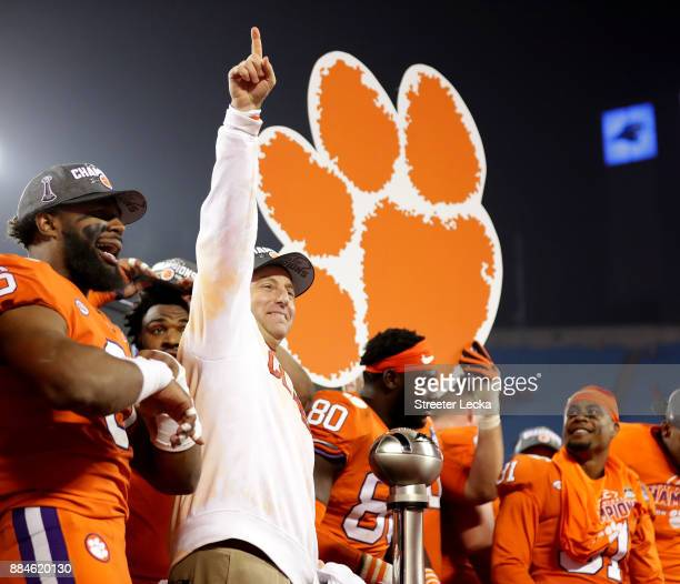 Head coach Dabo Swinney of the Clemson Tigers celebrates after defeating the Miami Hurricanes 38-3 in the ACC Football Championship at Bank of...