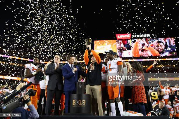 Head coach Dabo Swinney of the Clemson Tigers celebrates his teams 44-16 win over the Alabama Crimson Tide with the trophy in the CFP National...