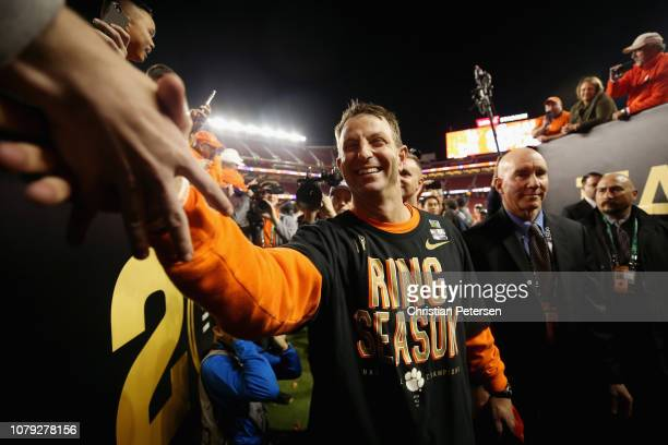 Head coach Dabo Swinney of the Clemson Tigers celebrates his teams 4416 win over the Alabama Crimson Tide in the CFP National Championship presented...
