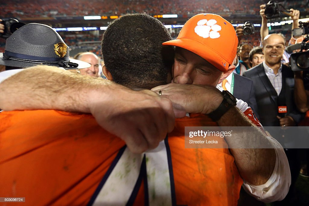 Head coach Dabo Swinney of the Clemson Tigers celebrates with Deshaun Watson #4 after defeating the Oklahoma Sooners with a score of 37 to 17 to win the 2015 Capital One Orange Bowl at Sun Life Stadium on December 31, 2015 in Miami Gardens, Florida.