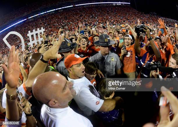 Head coach Dabo Swinney of the Clemson Tigers celebrates with fans on the field following Clemson's victory over the Auburn Tigers at Memorial...