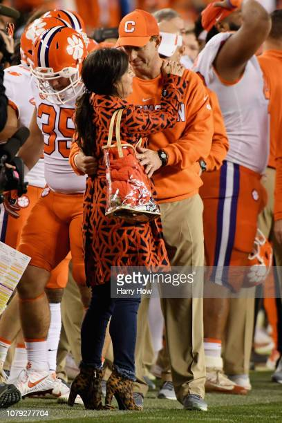 head coach Dabo Swinney of the Clemson Tigers celebrates with his wife Kathleen Bassett after his teams 4416 win over the Alabama Crimson Tide in the...