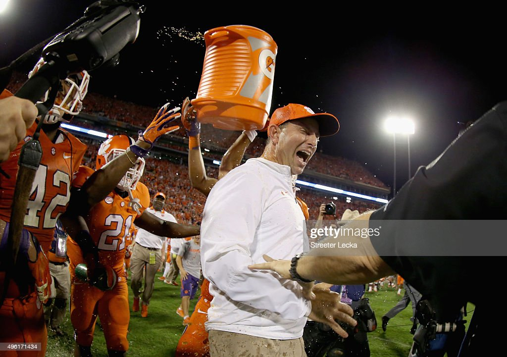 Head coach Dabo Swinney of the Clemson Tigers celebrates with his team after defeating the Florida State Seminoles 23-13 at Memorial Stadium on November 7, 2015 in Clemson, South Carolina.