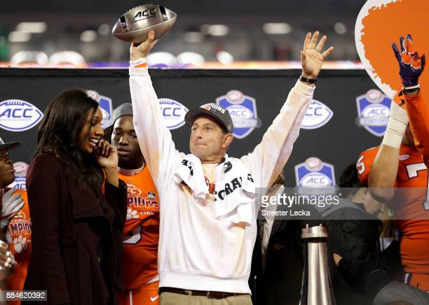 Head coach Dabo Swinney of the Clemson Tigers celebrates with the trophy after defeating the Miami Hurricanes 383 in the ACC Football Championship at...