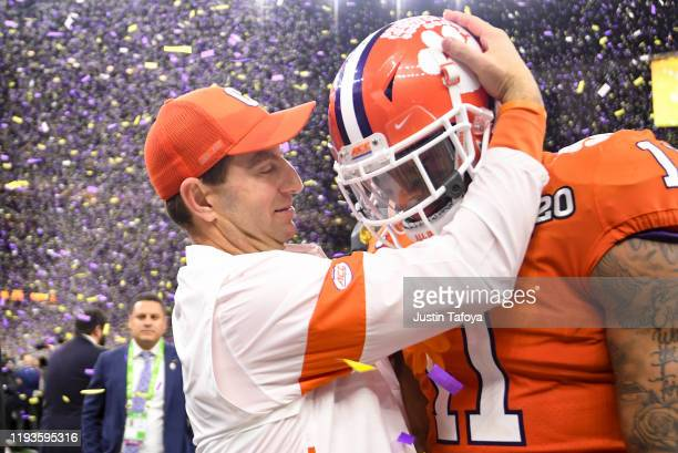 Head coach Dabo Swinney of the Clemson Tigers embraces Isaiah Simmons during the College Football Playoff National Championship held at the...