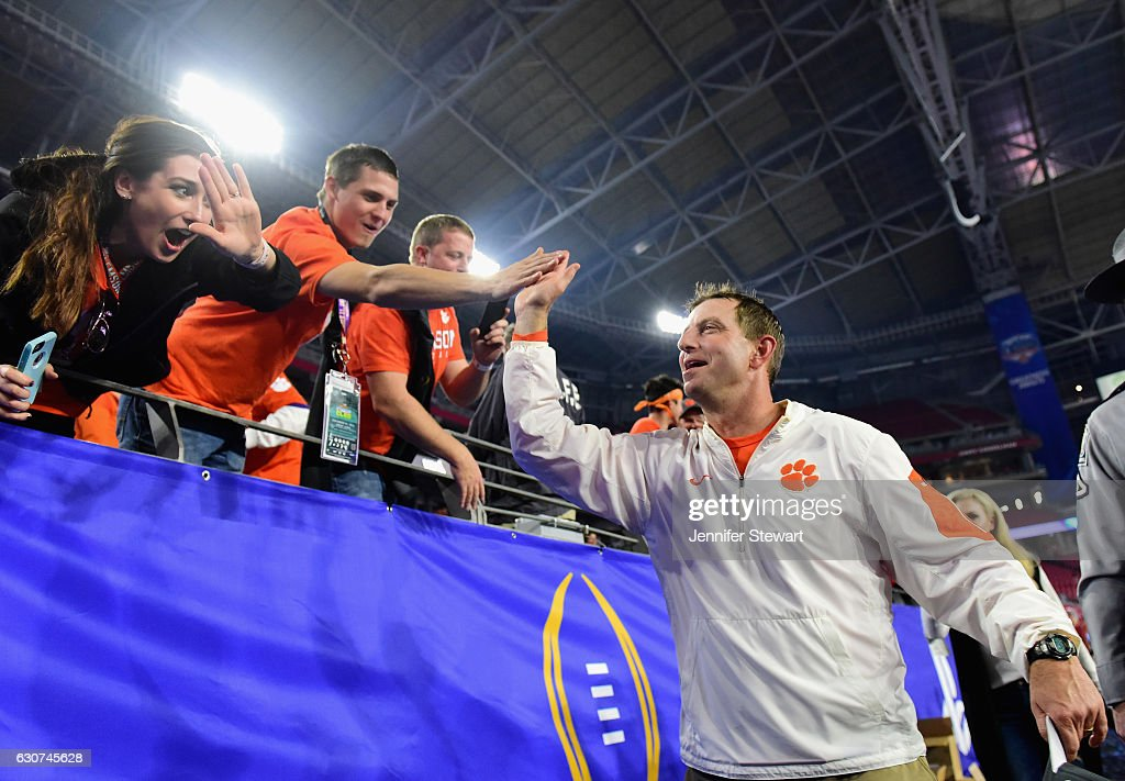 Head coach Dabo Swinney of the Clemson Tigers greets fans after the Clemson Tigers beat the Ohio State Buckeyes 31-0 to win the 2016 PlayStation Fiesta Bowl at University of Phoenix Stadium on December 31, 2016 in Glendale, Arizona.