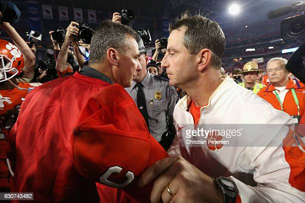 Head coach Dabo Swinney of the Clemson Tigers greets head coach Urban Meyer of the Ohio State Buckeyes after the Clemson Tigers defeated the Ohio...