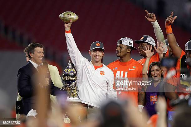 Head coach Dabo Swinney of the Clemson Tigers holds the Fiesta Bowl trophy after the Clemson Tigers beat the Ohio State Buckeyes 31-0 to win the 2016...