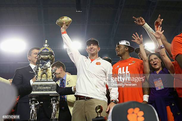 Head coach Dabo Swinney of the Clemson Tigers holds the Fiesta Bowl trophy after the Clemson Tigers beat the Ohio State Buckeyes 310 to win the 2016...