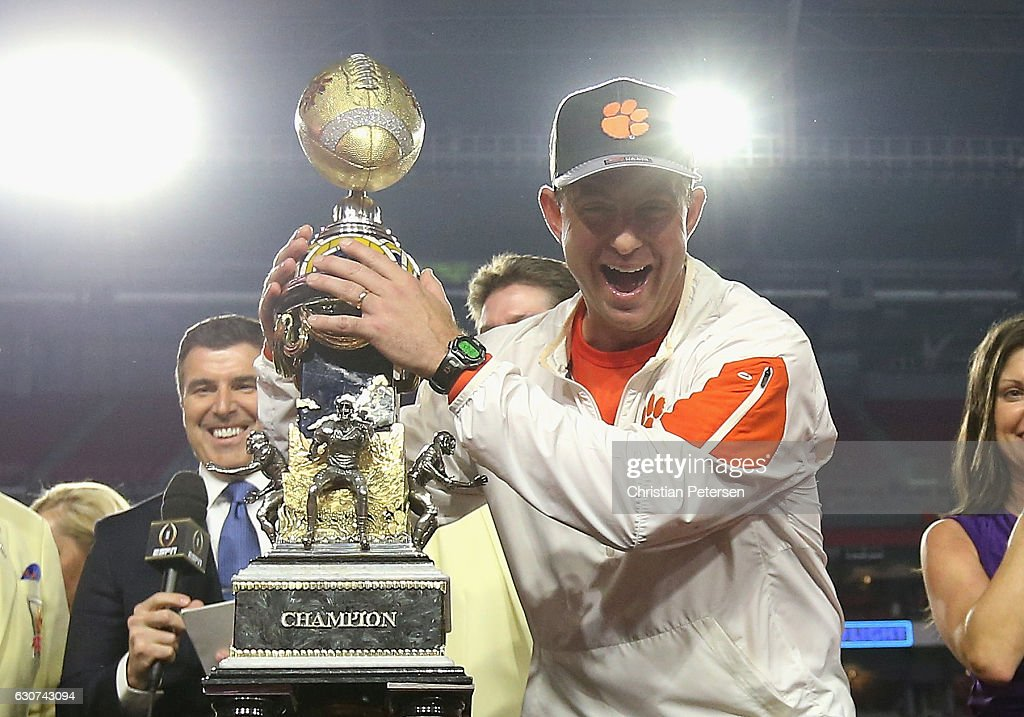 Head coach Dabo Swinney of the Clemson Tigers holds the Fiesta Bowl trophy after the Clemson Tigers beat the Ohio State Buckeyes 31-0 to win the 2016 PlayStation Fiesta Bowl at University of Phoenix Stadium on December 31, 2016 in Glendale, Arizona.