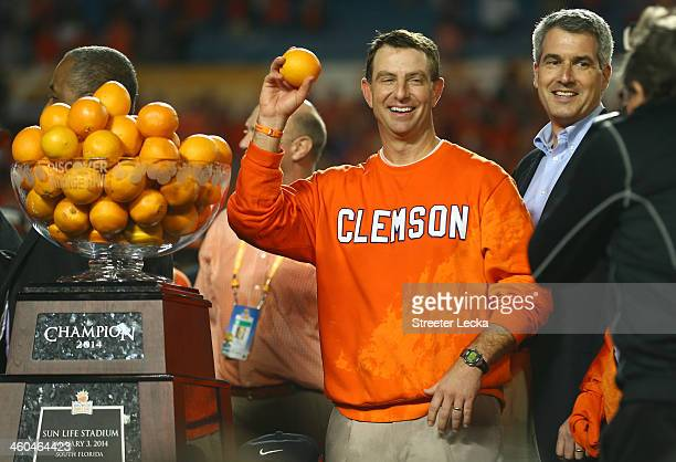Head coach Dabo Swinney of the Clemson Tigers holds up an orange after defeating the Ohio State Buckeyes during the Discover Orange Bowl at Sun Life...